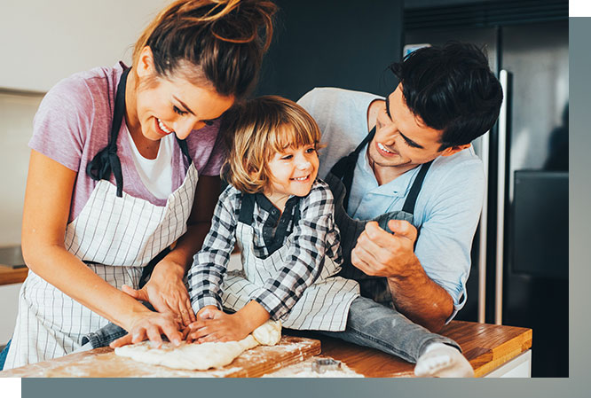 Happy mom, dad and toddler boy playing with dough.