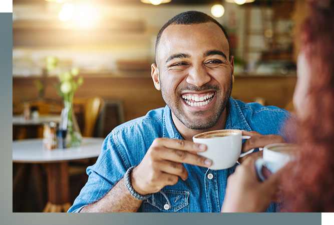 Smiling man holding coffee cup